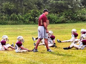 Charlie B. Carroll, Jr coaching youth football team